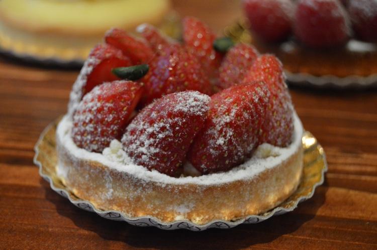 Left: Tarte citron meringuée (lemon meringue pie) Right: Tarte aux framboises (raspberry tart), Foreground: Tarte aux Fraises (strawberry tart)